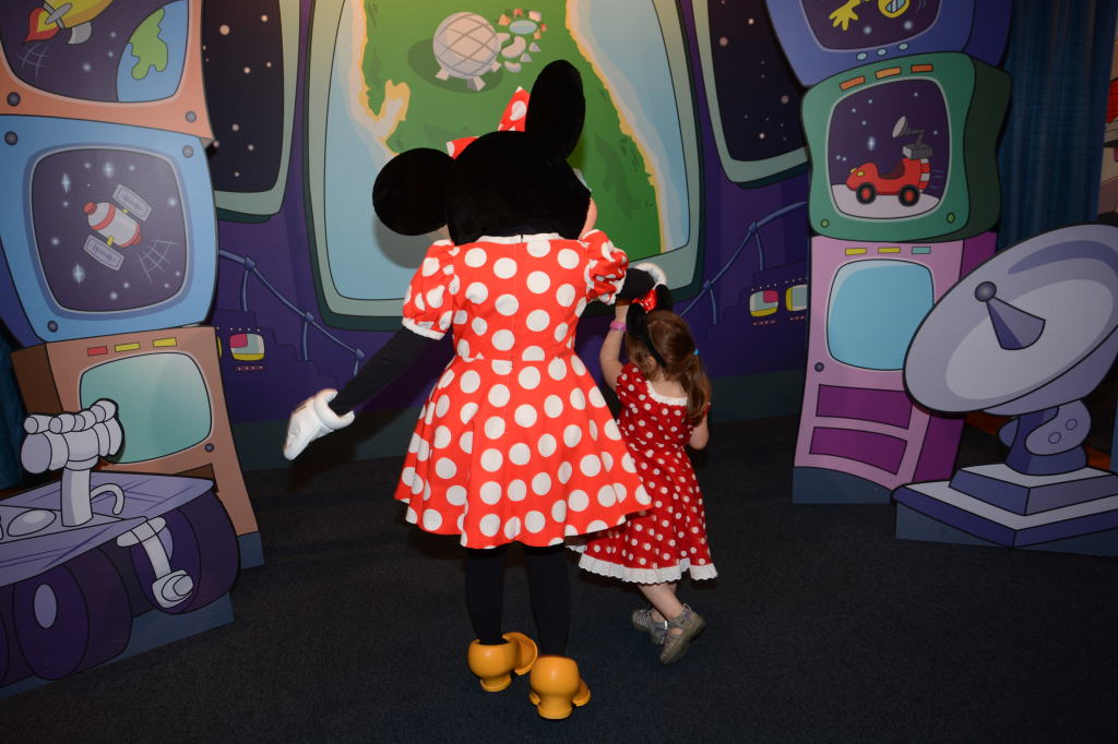 Just a little twirling with her new pal, Minnie
