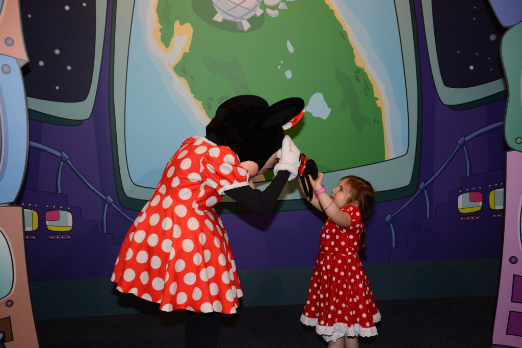 Maya trying to put her headband on Minnie