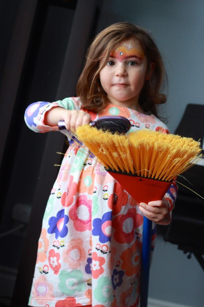 Maya brushing her little broom...this child of mine cracks me up daily.