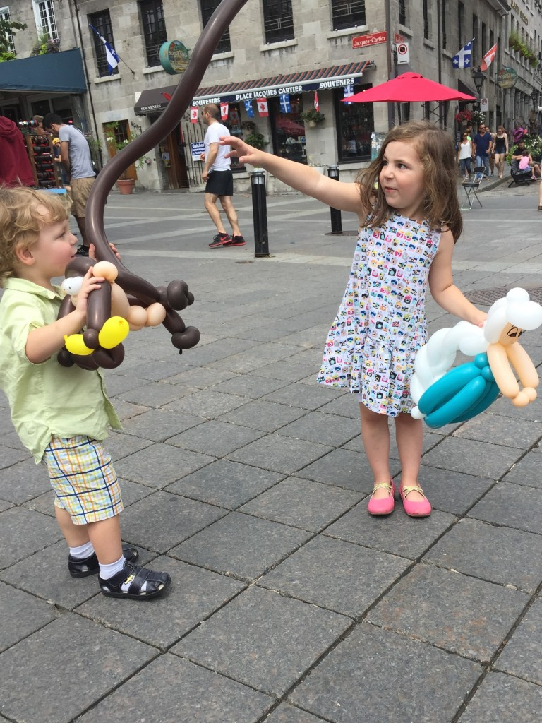 "In Montreal we found a ""balloon lady"" who made Maya an Elsa and Jacob a monkey. They were really neat!"